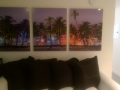 Acrylic Print: Palm Trees in Front of Buildings