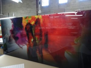 Acrylic abstract multicolored print with gloss.