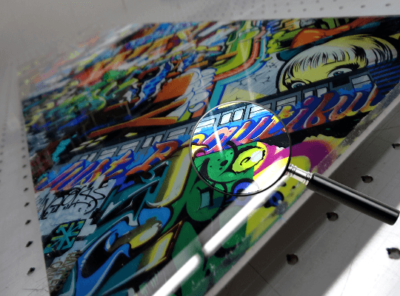 Acrylic print of multicolored urban graffiti.