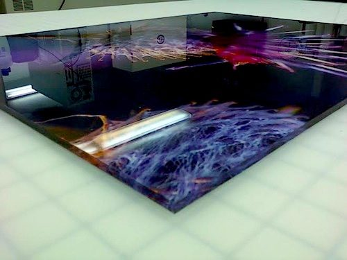 Acrylic print abstract purple images on black background.