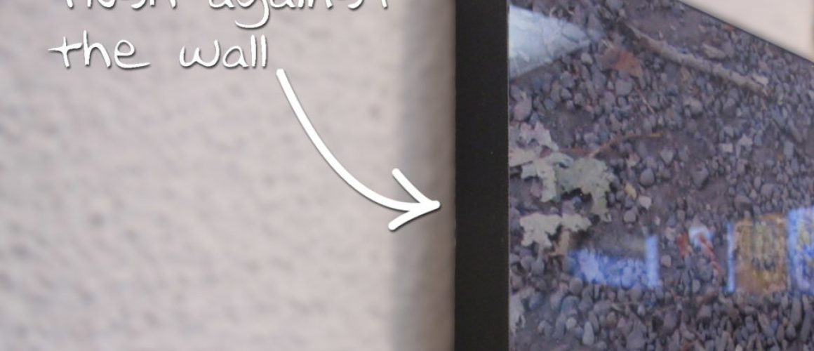 "Image shows 1"" mount that lies flush against wall."