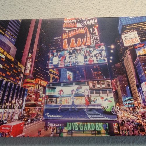 Acrylic print of a big city street with lights and billboards.