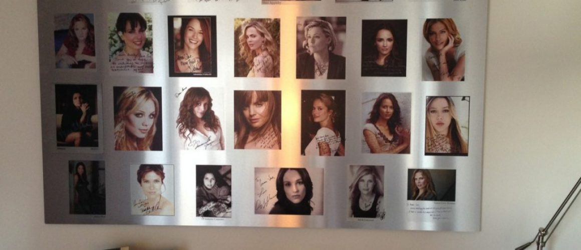 Metal print of a montage of pictures of different women and their autographs.