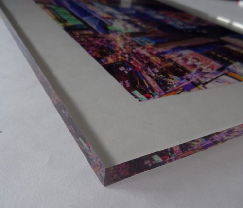 """Image shows 3/8"""" thickness of acrylic print."""