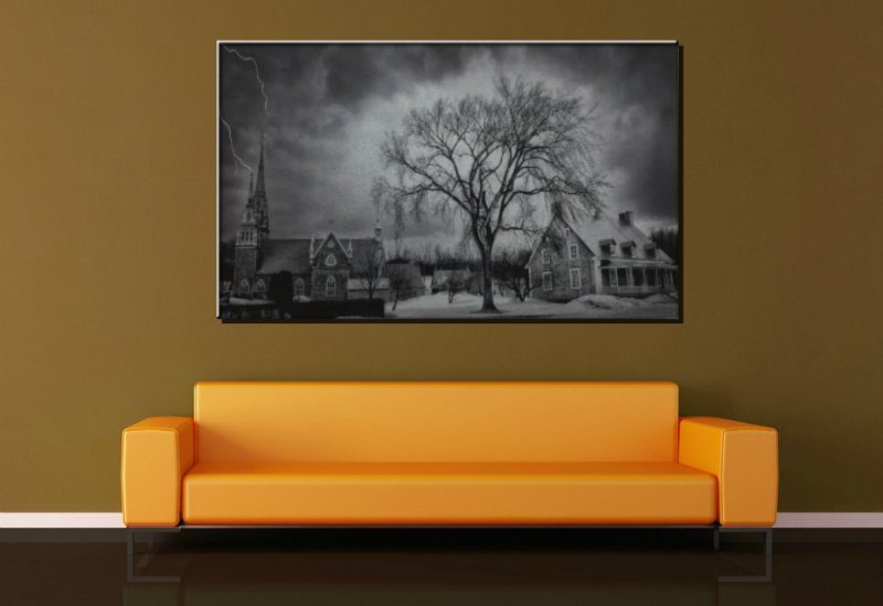 Metal print in black and white of a big tree and houses.