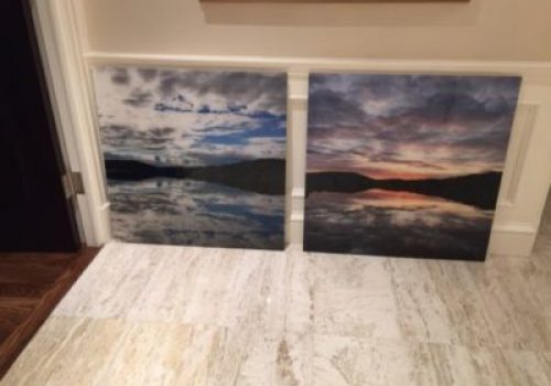 Acrylic print of clouds over mountains and water seperated into two panels.