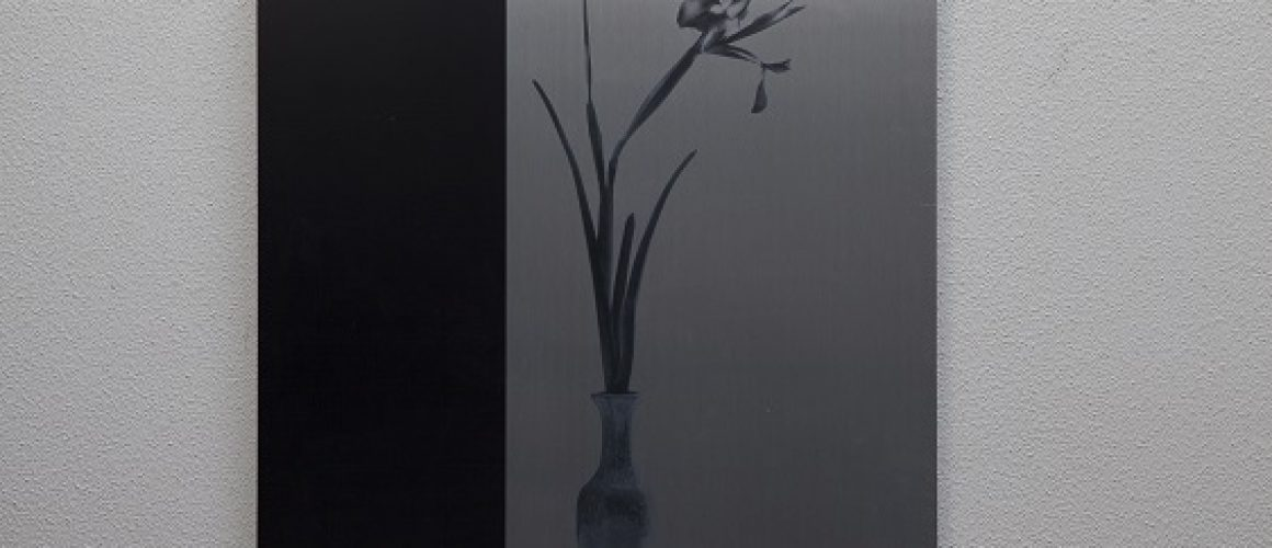 Brushed metal print of flower in vase with a thick black border on the left.