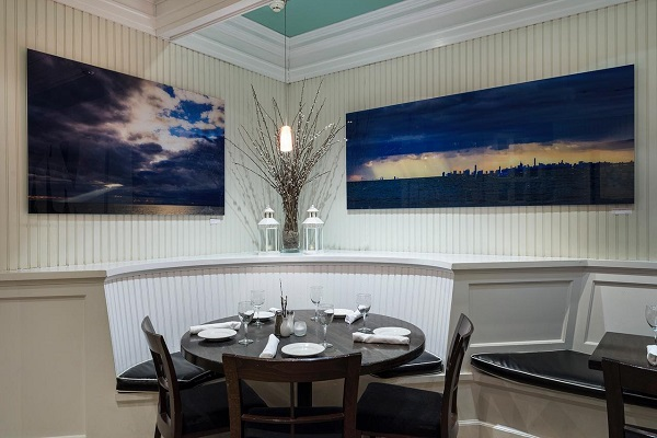 commercial acrylic prints hanging in a restaurant