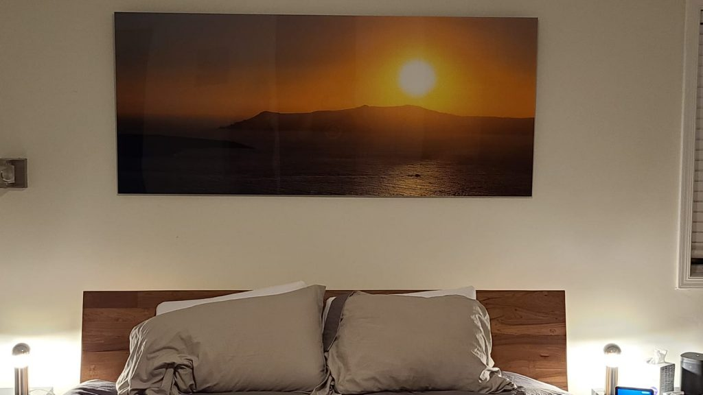 above the bed art of a sunset